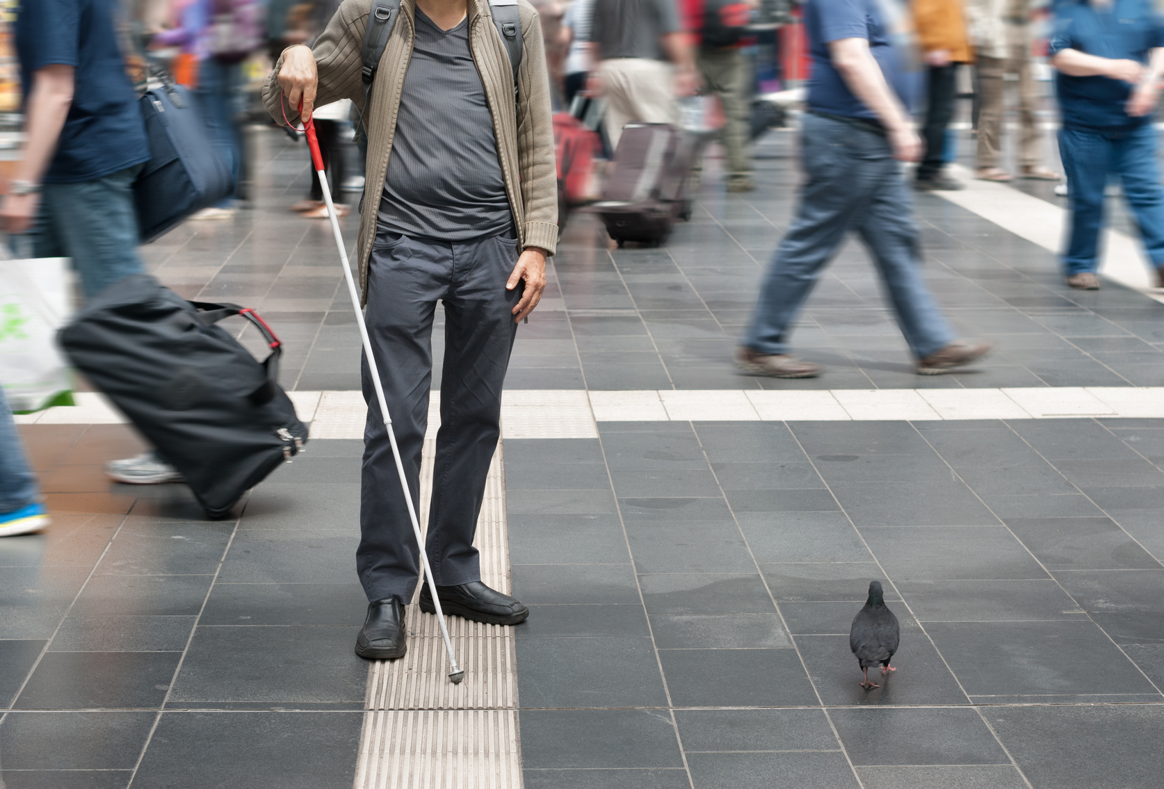 Visually impaired person uses the tactile guidance system in the station